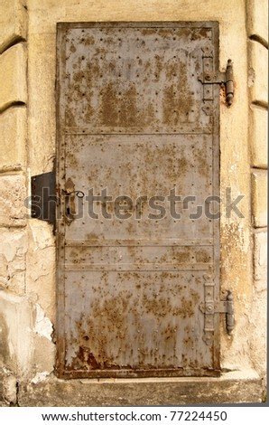 Historical Rusty Iron Door in a Stone Entry, The Czech Republic - stock photo