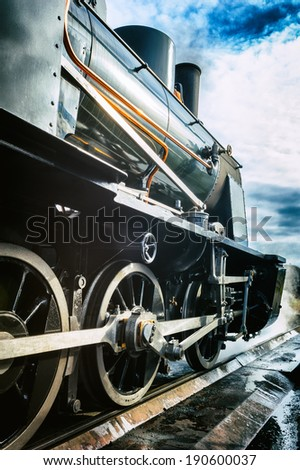 Historical steam engine train in motion  - stock photo
