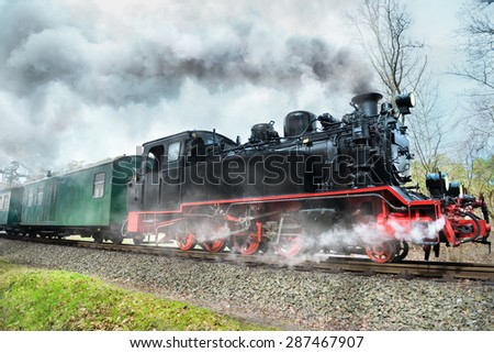 Historical steam train on island Rugen in Germany - stock photo