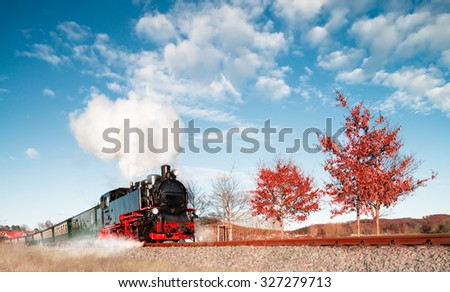 Historical steam train on island Rugen (Ruegen) in North-East of Germany - stock photo
