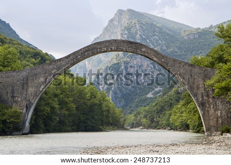 Historical stone bridge of Plaka at Epiros, above Arahtos river - stock photo