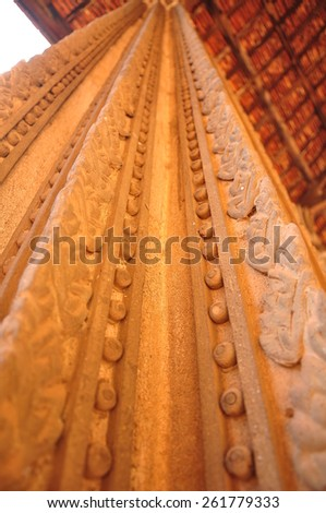 historical stone pillar of Public temple in Laos, using ant perspective technique. - stock photo