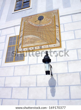 Historical sun clock on a wall in Cesky Krumlov - stock photo