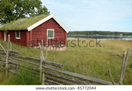 Historical Swedish cottage near the sea - stock photo