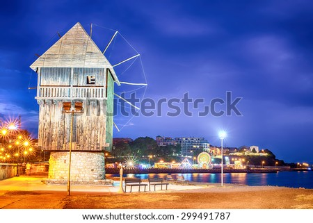 Historical windmill in the Old Town of Nesebar (Bulgaria) at night. Famous beautiful historical place in the coat of Black Sea. - stock photo