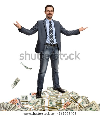 Hit the jackpot / lucky gentleman presents itself surrounded by money - isolated on white background  - stock photo