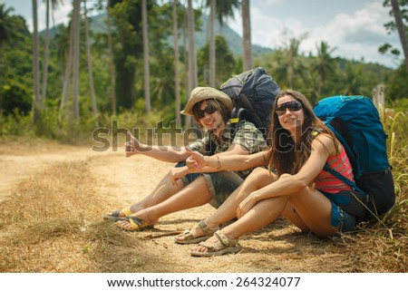 hitchhiking in the tropics - stock photo