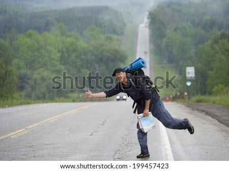 Hitchhiking travel man at the route - stock photo