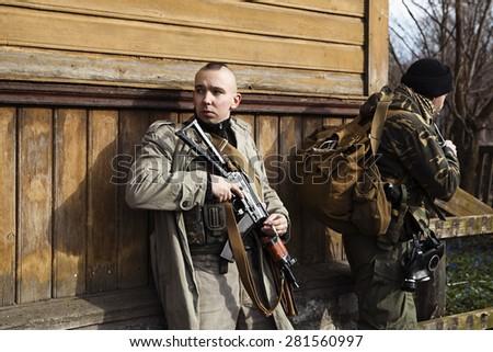 Hitman on operation of capturing the village - stock photo