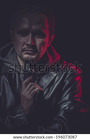 Hitman, secret agent with gun and red light - stock photo