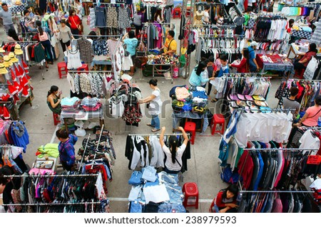 HO CHI MINH CITY, VIET NAM- DEC 20: Group of Asian young people join market day fair, sale off flea market for student in winter season,  lifestyle of Vietnamese people, Saigon, Vietnam, Dec 20, 2014 - stock photo