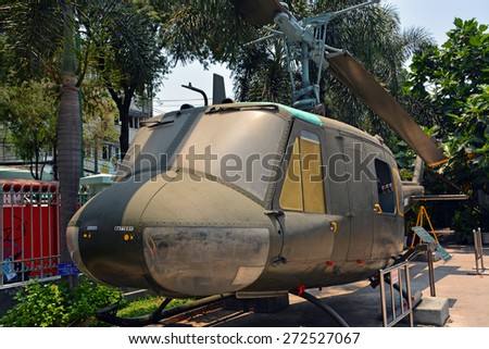 Ho Chi Minh City, Vietnam - April 10, 2015: American Huey Helicopter on display at the War Remnants Museum. - stock photo