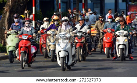 Ho Chi Minh City, Vietnam - April 07, 2015: Over 4 Million Motorcycles & Scooters dominate the busy streets of Vietnam's largest city - Saigon (Ho Chi Minh City). - stock photo