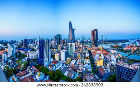 HO CHI MINH CITY, VIETNAM - AUGUST 07, 2014 : Saigon riverside by night view on high at downtown center with buildings across riverside Saigon river Ho Chi Minh City - stock photo