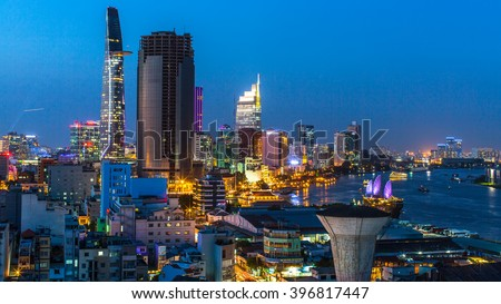 HO CHI MINH CITY, VIETNAM - CIRCA JAN, 2016: Top view of Saigon River at night time. Saigon River (the length of 256 kilometers) is most important to Ho Chi Minh City as it is the main water supply. - stock photo