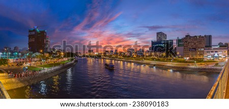 HO CHI MINH CITY, VIETNAM - DECEMBER, 17, 2014: Area view from Mong bridge with the houses and modern buildings at sunset in Ho Chi Minh City. - stock photo