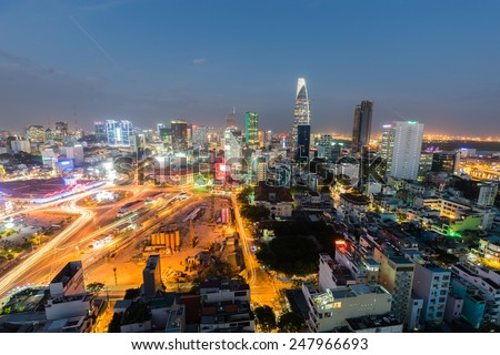 HO CHI MINH CITY, VIETNAM - December 9, 2014 - Downtown Saigon, Ben Thanh market and the surroundings in twilight. Ben Thanh market is a very famous one in HCMC and located in the center of the City. - stock photo