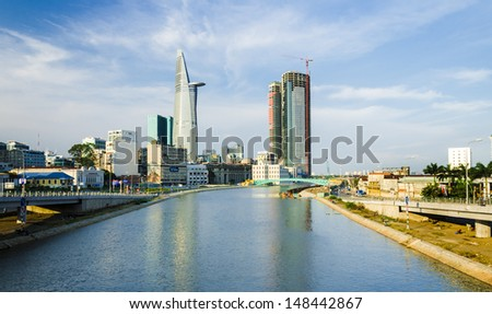 HO CHI MINH CITY, VIETNAM - FEB 24: Most of banks and finance firms are located on the left side of Tau Hu canal, where have been called Saigon Wall Street in Ho CHi Minh City on Feb 24, 2012 - stock photo