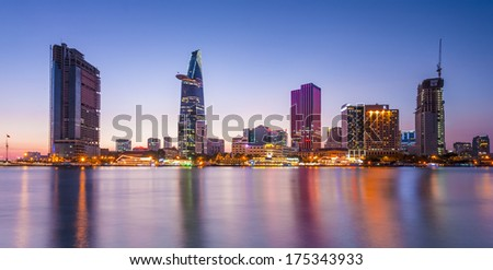 HO CHI MINH CITY, VIETNAM - FEB 6: Night view of Business and Administrative Center of Ho Chi Minh city on Saigon riverbank on Feb 6, 2014 - stock photo