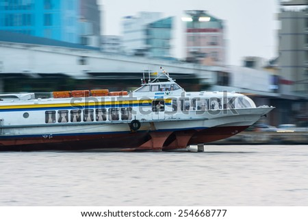 Ho Chi Minh City, VietNam FEBRUARY, 10, 2015: high speed tourist boat moving on SAIGON river ,Ho Chi Minh city, Vietnam. Ho Chi Minh city is the biggest city in Vietnam. - stock photo