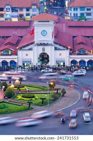 HO CHI MINH CITY, VIETNAM - JANUARY 3, 2015 :  Aerial view of Ben Thanh market with traffic near by at evening, the iconic and antique building in Saigon from 1859.  - stock photo
