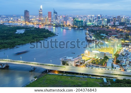 HO CHI MINH CITY, VIETNAM - JUL 9: City skyline aerial view and foogy pollution at blue hour with colorful cloud and skyscrapers of city central on July 9, 2014 - stock photo