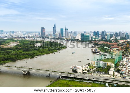 HO CHI MINH CITY, VIETNAM - JUL 1: City skyline aerial view and foogy pollution with clouds and skyscrapers of city central on July 1, 2014 - stock photo