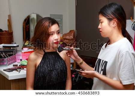 Ho Chi MInh City, Vietnam - June 23, 2016 : staff professional makeup is makeup for client to prepare for an upcoming party - stock photo