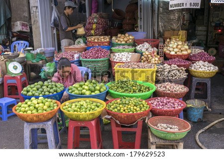 HO CHI MINH CITY, VIETNAM - MAR 1: A vegetables and fruits shop on the street of Ho Chi Minh City on Mar 1, 2014. Market on the street are an indigenous culture in Vietnam - stock photo