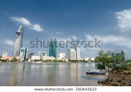 Ho Chi Minh City, Vietnam - 7 MARCH: Cityscape of Ho Chi Minh city, viewed over Saigon river on 7 March, 2015. Ho chi minh is the largest city in Vietnam with population around 10 million people. - stock photo