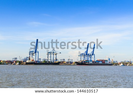 HO CHI MINH CITY, VIETNAM - NOVEMBER 25: Bulk-handling crane at Cat Lai Port on November 25, 2012. Cat Lai Terminal is the biggest, most modern container facility in Vietnam. - stock photo