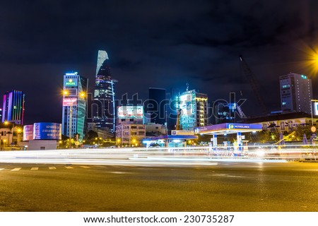 HO CHI MINH CITY, VIETNAM - NOVEMBER 5, 2014 - View of a corner in downtown by night. Ho Chi Minh city is the biggest city in Vietnam and the center of business and finance, commerce in Vietnam. - stock photo