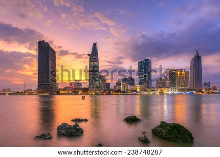 HO CHI MINH CITY/VIETNAM - SEPTEMBER 9 2014 : cityscape ( night view ) of Saigon river at downtown ( center ) of ho chi minh city, Vietnam in sunrise or sunset - stock photo