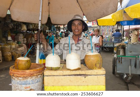 Ho Chi Minh City, Vietnam-30th Oct 2013: Coconut seller in Cholon market. Cholon is the Chinatown area of the city. - stock photo
