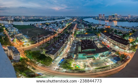 HO CHI MINH , VIET NAM- SEPTEMBER  30, 2014 : Panoramic night view of THANH DA peninsula, Ho Chi Minh city (or Saigon) in sunset, Vietnam. - stock photo