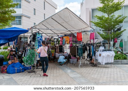 HO CHI MINH, VIETNAM - JULY 28: Unidentifed people shopping at Flea market Phu My Hung, Distric 7 on July 28, 2014 in Ho Chi Minh, Vietnam. - stock photo