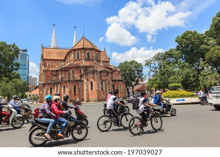 HO CHI MINH, VIETNAM - June 6, 2014: Traffic at Notre Dame cathedral ( Duc Ba Church ), is a cathedral located in the downtown of Ho Chi Minh City. - stock photo