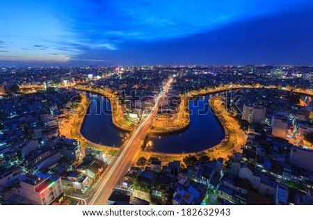 HO CHI MINH, VIETNAM - June 19, Vietnam with the road across the Nhieu Loc canal and houses, Ho Chi Minh City, Vietnam on June 19, 2013. - stock photo