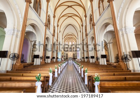 HO CHI MINH, VIETNAM - May 28, 2014: Interior of Saigon Notre-Dame Basilica of Our Lady of The Immaculate Conception is a cathedral located in the downtown of Ho Chi Minh City, Vietnam  - stock photo