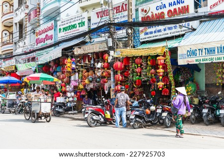 HO CHI MINH, VIETNAM - OCT 5, 2014: Architecture and motorbikes traffic on the street in Hochiminh (Saigon). Saigon is the largest city in Vietnam - stock photo