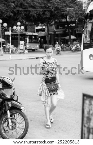 HO CHI MINH, VIETNAM - OCT 6, 2014: Unidentified tourist visits Ho Chi MInh. Ho CHi Minh is a popular destination for tourists visiting Vietnam - stock photo