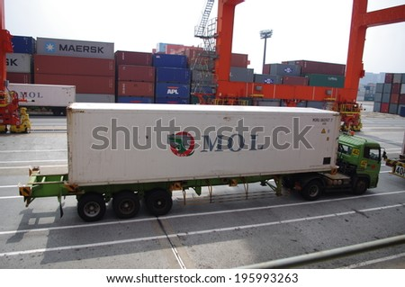 HO CHI MINH, VIETNAM - SEPTEMBER 23 : Container truck waiting for loading refrigerator container box to Cargo ship at Ho Chi Minh port in Vietnam, Vietnam is leader food export in asia, on September 23 , 2013 - stock photo