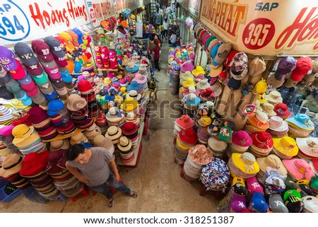 HO CHI MINH VILLE, VIETNAM, FEBRUARY 26, 2015 : Hat department in the old traditional market of Cho Binh Tay in the Chinatown district of Ho Chi Minh Ville, (Saigon), Vietnam. - stock photo