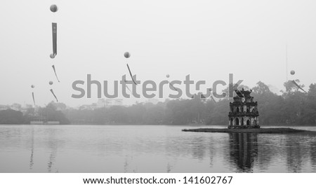 Ho Hoan Kiem, the little lake in the old part of Hanoi, Vietnam, with the Tortoise Tower. - stock photo