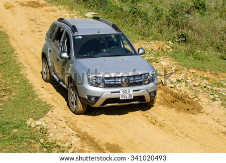 Hoabinh, Vietnam - Nov 17, 2015: Renault Duster 4x4 AT car running on the mountain road in Vietnam. Renault Duster is a compact SUV with great off-road capabilities. - stock photo
