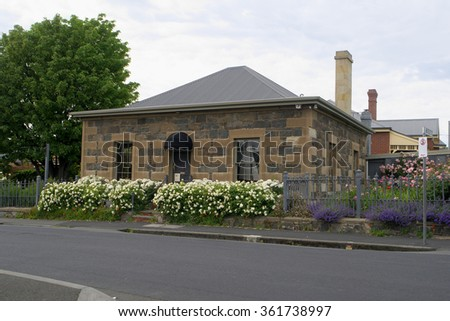 HOBART, AUSTRALIA - NOVEMBER 08: Residential buildings that are from first settlement period in historic Battery Point November 08, 2015 in Hobart, Australia - stock photo