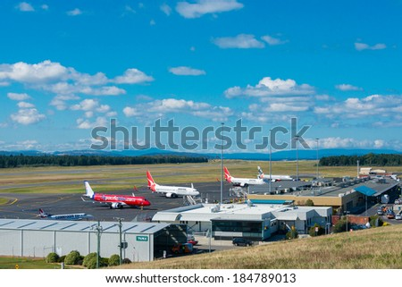 HOBART, TASMANIA/AUSTRALIA, MARCH 31ST: Image of a Jetstar Australia, Virgin Australia and Qantas passenger airliners at Hobart Airport on 31st March, 2014 in Hobart - stock photo