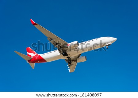 HOBART, TASMANIA/AUSTRALIA, MARCH 13TH: Image of a Qantas passenger airliner  landing at Hobart Airport on 13th March, 2014 in Hobart - stock photo