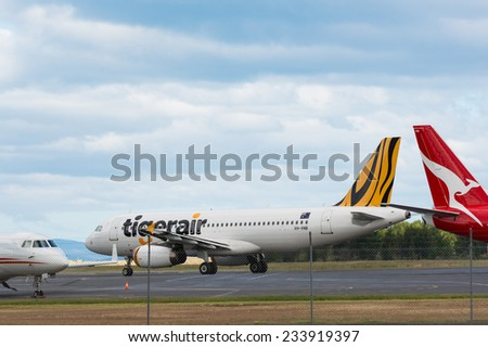 HOBART, TASMANIA/AUSTRALIA, NOVEMBER 18th: Image of a Tigerair Australia & Qantas passenger airliner at Hobart Airport on 18th November, 2014 in Hobart - stock photo