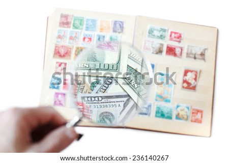 Hobby concept: sale of rare postage stamps - stock photo